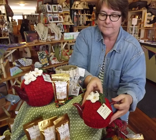 Artist of the Month Joan Lester sets up her display of tea-cozies and tea blends.